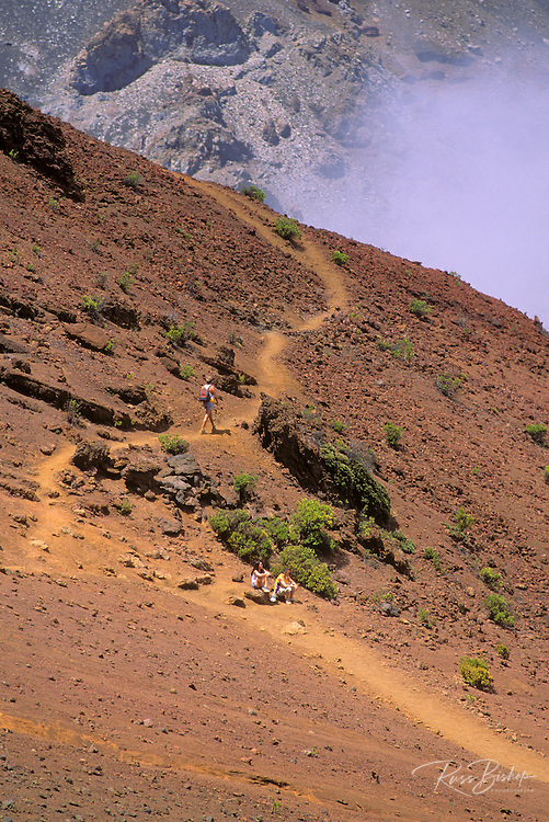 Hikers on the Sliding Sands Trail in Haleakala Crater, Haleakala National Park, Maui, Hawaii