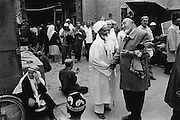 Xinjiiang Uygur Autonomous region. Kashgar. Men greet one another outside Id Kah Mosque in Kashgar's old town.