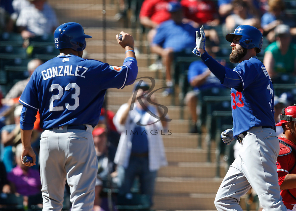 Mar 9, 2016; Tempe, AZ, USA; Los Angeles Dodgers left fielder Scott Van Slyke (33) celebrates with Adrian Gonzalez (23) after hitting a two run homerun in the third inning during a spring training game against the Los Angeles Angels at Tempe Diablo Stadium. Mandatory Credit: Rick Scuteri-USA TODAY Sports