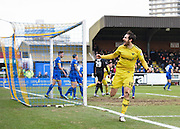 Oxford forward Danny Hylton bundles the ball over the line and celebrates the opening goal during the Sky Bet League 2 match between AFC Wimbledon and Oxford United at the Cherry Red Records Stadium, Kingston, England on 27 February 2016. Photo by David Charbit.