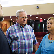 FORT LAUDERDALE, FLORIDA, NOVEMBER 2, 2018<br /> Rabbi David Spey, left, speaks with congregants Herbert, 72, and Arlene Moses, 76, who went to Pittsburgh's Squirrel Hill Synagogue when they lived there,  following family Shabbat service at Temple Bat Yam of East Fort Lauderdale. The reform congregation of 220 families was congregating for the first time since the deadly shooting in Pittsburgh on October 27.<br /> (Photo by Angel Valentin/Freelance)