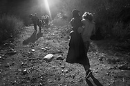 Refugees from Afghanistan and Syria that arrived in boats on the shores of Lesbos near Molivos walk out from the beach to a transit camp, on 04 November, 2015. Lesbos, the Greek vacation island in the Aegean Sea between Turkey and Greece, faces massive refugee flows from the Middle East countries.