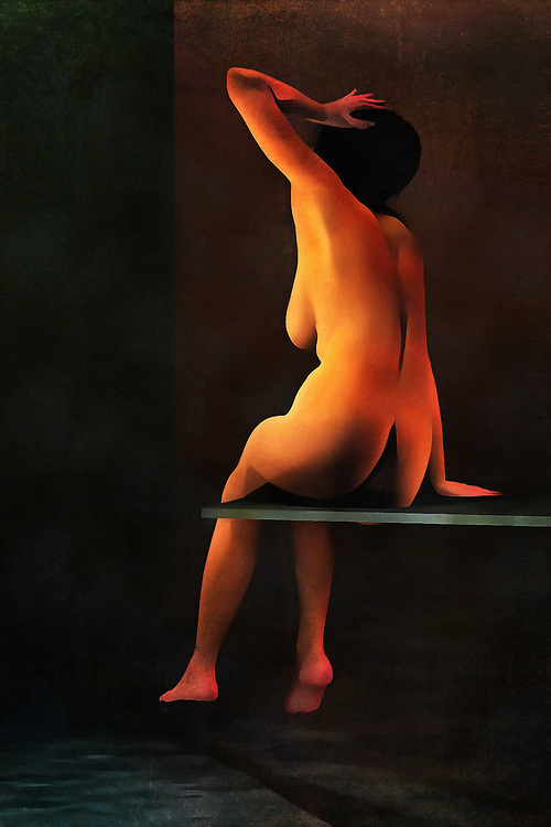 A nude woman sits on a diving board, which rests above a swimming pool. She has a hand to her head, although we can't say why. Her nude form sits on the board, and she is clearly looking at something beyond the water. This woman is paying attention to something. When the moment has passed, we can imagine that she's going to get in the water. It is likely a beautiful day, or perhaps the swimming pool is indoors. Regardless, we appreciate the attention to detail and uniqueness of the human form in this piece, available in the form of wall art.