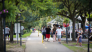 People walk the Tammany Trace in Abita Springs Park before fireworks on July 2, 2017