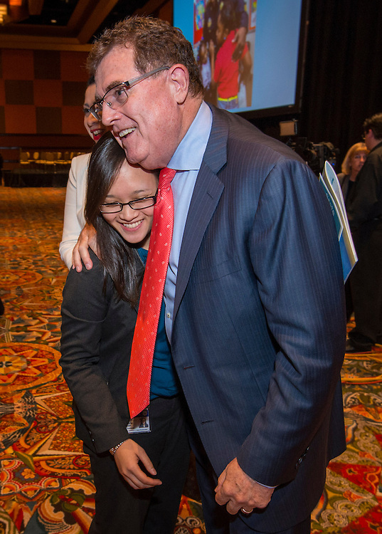 Houston ISD Superintendent Dr. Terry Grier hugs Sharpstown counselor Victoria Doan during the State of the Schools luncheon, February 11, 2015.