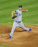 Jul. 15 2011; Phoenix, AZ, USA; Los Angeles Dodgers pitcher Clayton Kershaw (22) delivers a pitch during the second inning against the Arizona Diamondbacks at Chase Field. The Dodgers defeated the Diamondbacks 6-4. Mandatory Credit: Jennifer Stewart-US PRESSWIRE..