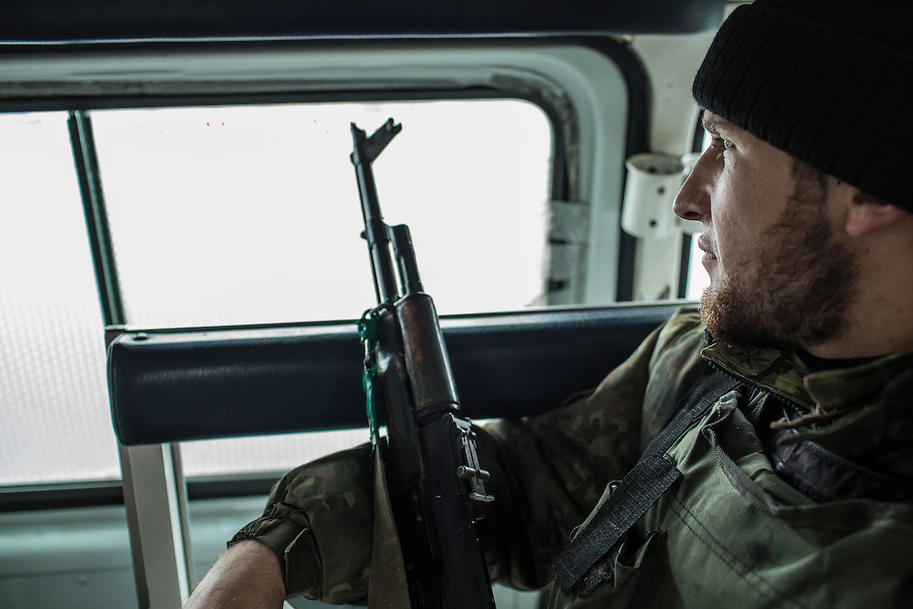 PIKSY, UKRAINE - NOVEMBER 19, 2014: Ivan, a member of the Dnipro-1 brigade, a pro-Ukraine militia, rides to the front in Pisky, Ukraine. CREDIT: Brendan Hoffman for The New York Times