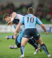 Rory Sidey (Rebels) takes on Matt Lucas (Waratahs) during the Round 15 match of the 2013 Super Rugby Championship between RaboDirect Rebels vs HSBC Waratahs at AAMI Park, Melbourne, Victoria, Australia. 24/05/0213. Photo By Lucas Wroe