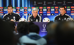 CARDIFF, WALES - Tuesday, August 12, 2014: Real Madrid Manager Carlo Ancelotti [c] with goalkeeper Iker Casillas [L] and Gareth Bale [R] during a press conference ahead of the UEFA Super Cup at Cardiff City Stadium.  (Pic by Pool/Getty Images/Propaganda)
