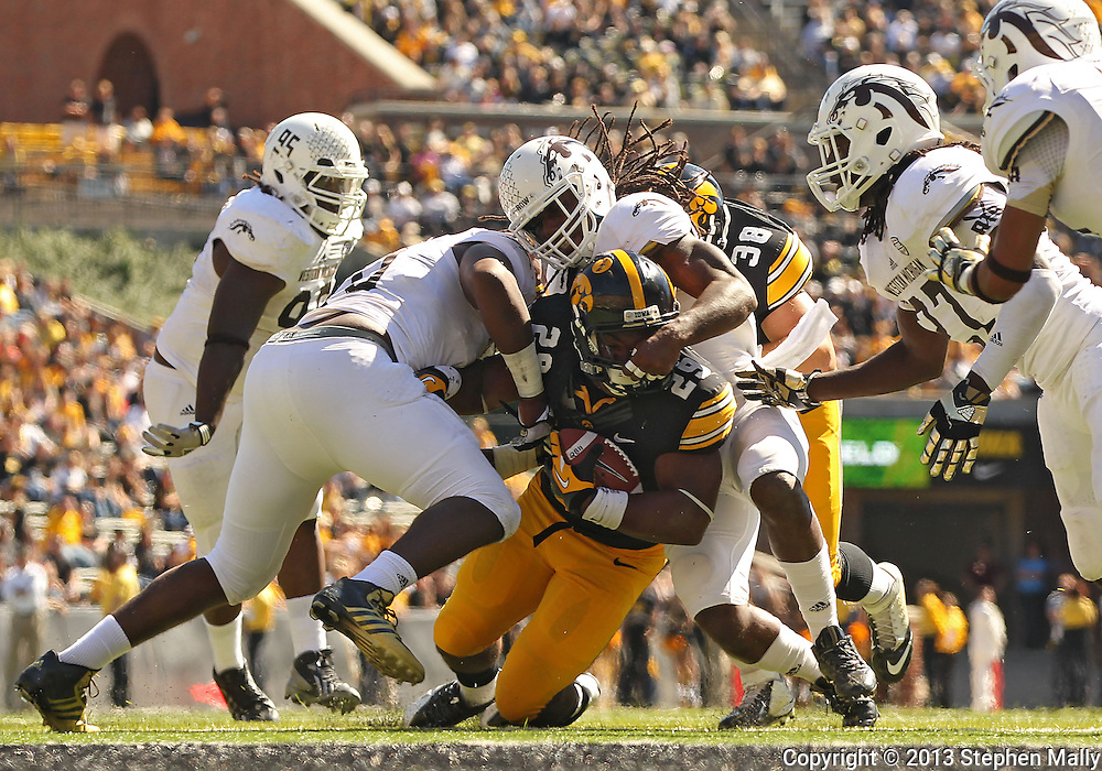 September 21 2013: Iowa Hawkeyes running back LeShun Daniels (29) is pulled down by Western Michigan Broncos linebacker Desmond Bozeman (10) and Western Michigan Broncos safety Demetrius Pettway (2) during the fourth quarter of the NCAA football game between the Western Michigan Broncos and the Iowa Hawkeyes at Kinnick Stadium in Iowa City, Iowa on September 21, 2013. Iowa defeated Western Michigan 59-3.