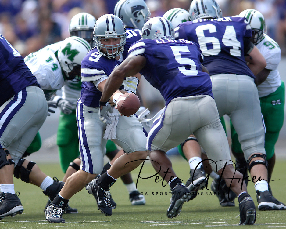 Kansas State quarterback Dylan Meier (9) hands the ball off to running back Thomas Clayton (5) against Marshall, at Bill Snyder Family Stadium in Manhattan, Kansas, September 16, 2006.  The Wildcats beat the Thundering Herd 23-7.