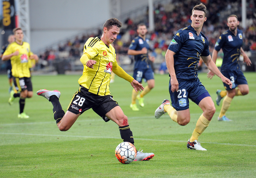 Phoenix's Joel Stevens, left, plays across in front of Central Coast Mariners' Jake McGing in the A-League football match at AMI Stadium, Christchurch, New Zealand, Saturday, January 30, 2016. Credit:SNPA / Ross Setford