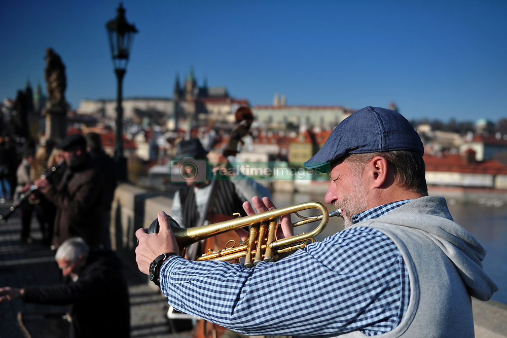 November 18, 2018 - Prague, Czech Republic - Street musician playing music together with his band on the Charles bridge in Prague in the Czech Republic. (Credit Image: © Slavek Ruta/ZUMA Wire)