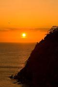 Sea birds flying at sunset in Pacheca Island. Las Perlas Archipelago, Panama province, Panama, Central America.