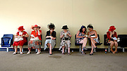 Racegoers take a break from the sunshine at Ascot Ladies Day 17th June 2010. © under license to London News Pictures..