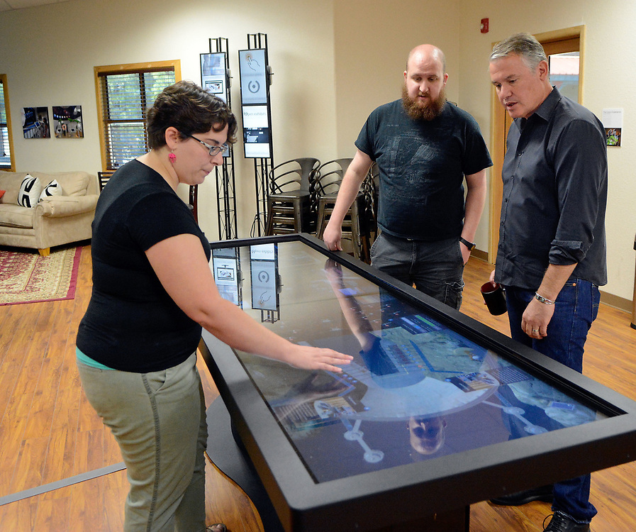 jt052617i/ a sec/jim thompson/ Left to right -Producer, Becky O'Neill and softwear developer Nick Schrandt talk with Ideum CEO/Founder Jim Spadaccini about the touch table top that will be used at the Hoover Dam Information Center. Friday May. 26, 2017. (Jim Thompson/Albuquerque Journal)