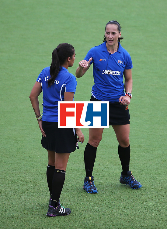ROSARIO, ARGENTINA - DECEMBER 05: Umpire Michelle Joubert (R) talks during the Hockey World League Final Pool A match between the Netherlands and Germany at Estadio Mundialista de hockey on December 5, 2015 in Rosario, Argentina.  (Photo by Chris Brunskill/Getty Images)
