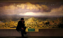 A visitor sits by a display showing a model of a scene from the Korean war at the Museum to Commemorate the War to Resist American Aggression and Aid Korea, in Dandong, Liaoning Province, China, 07 April 2013. Built in 1958, the museum built atop a hill overlooking Dandong tells China's side of the story of the Korean war where Chinese forces rush to the aid of North Korea against US aggression. China on 07 April said its embassy in Pyongyang was still 'operating normally' following North Korea's warning to diplomats that it could only guarantee their safety until Wednesday. Beijing had asked North Korea to protect the safety and interests of Chinese citizens and businesses in the country.