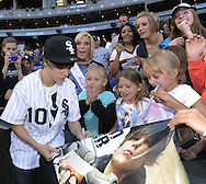 CHICAGO - MAY 03:  Pop music star Justin Bieber greets fans after throwing out a ceremonial first pitch prior to the game between the Chicago White Sox and Kansas City Royals on May 03, 2010 at U.S. Cellular Field in Chicago, Illinois.  (Photo by Ron Vesely)