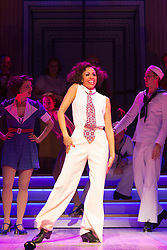 © Licensed to London News Pictures. 30/01/2015. London, England. Debbie Kurup as Reno Sweeney performing at the centre. The Sheffield Crucible Theatre production of Cole Porter's classic musical comedy, Anything Goes, opens at the New Wimbledon Theatre, London, before embarking on a UK tour. Opening on 29 January and running to 7 February 2015, the musical is directed by Daniel Evans with Debbie Kurup as Reno and Matt Rawl as Billy, featuring Hugh Sachs, Simon Rouse and Jane Wymark. Photo credit: Bettina Strenske/LNP