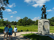Tourist view the Minute Man Statute, Minute Man National Historic Site, Concord, Massachusetts, USA.