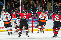 KELOWNA, BC - NOVEMBER 8: Kaedan Korczak #6 and Liam Kindree #26 throw their arms in the air after Kobe Mohr #25 of the Kelowna Rockets puts the puck in the net and scores a goal on Mads Søgaard #30 of the Medicine Hat Tigers at Prospera Place on November 8, 2019 in Kelowna, Canada. (Photo by Marissa Baecker/Shoot the Breeze)