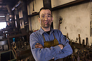 Blacksmith Frank Verga in a metal working shop in Charleston, SC