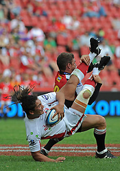JOHANNESBURG, South Africa, 02 April 2011. Saia Faingaa of the Reds looses his balance in the tackle mad by Andre Pretorius of the Lions during the Super15 Rugby match between the Lions and the Reds at Coca-Cola Park in Johannesburg, South Africa on 02 April 2011. .Photographer : Anton de Villiers / SPORTZPICS