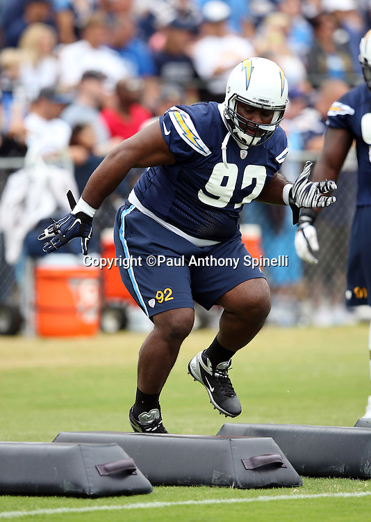 San Diego Chargers nose tackle Brandon Mebane (92) high steps through a coordination drill during the Chargers 2016 NFL minicamp football practice held on Tuesday, June 14, 2016 in San Diego. (©Paul Anthony Spinelli)