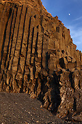 Basalt cliffs at sunset, at Reynisfjara beach, near Vik, Southern Iceland