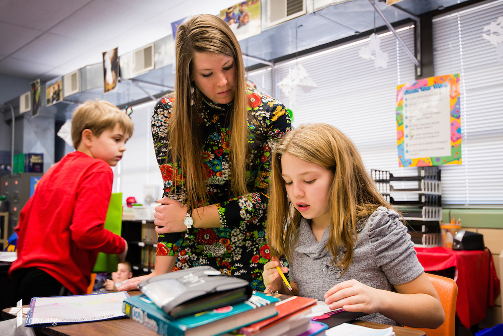4th grade teacher Alyssa Teschendorf works with a student at Holy Cross Lutheran Church and School on Friday, Feb. 21, 2014, in Collinsville, Ill. LCMS Communications/Erik M. Lunsford