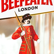 A close-up of the label on a bottle of Beefeater Gin, a dry gin distilled in London. Its label features one of the famous royal guards known as beafeaters.
