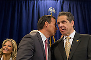 Albertson, New York, U.S. 26th October 2013. R-L, New York Governor ANDREW CUOMO , at right, endorses TOM SUOZZI, left of him, for Nassau County Executive, at the Albertson Veterans of Foreign Wars VFW Post. Democrat Suozzi, the former Nassau County Executive, and Republican incumbent Mangano face each other in a rematch in the upcoming November 5th election.