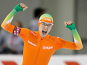 Marrit Leenstra of the Netherlands, celebrates her run in the women's 1,500-meter World Cup speedskating competition at the Utah Olympic Oval in Kearns, Utah, Saturday, Feb. 19, 2011. (AP Photo/Colin E Braley)