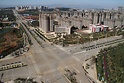 CHENGGONG, CHINA -China Out - Finland Out<br /> <br /> Ghost City <br /> <br /> Two vehicles and people make their way along a street on November 22, 2013 in Chenggong, Yunnan Province of China. Chenggong is a satellite city located just south of Kunming. As of 2012, much of the newly constructed housing in Chenggong is still unoccupied, and it is reportedly one of the largest ghost towns in Asia. According to a China Youth Daily report in July, at least 12 such ghost cities across the country have been found. Besides the best known of these - Ordos in North China's Inner Mongolia Autonomous Region, the list also included Changzhou in Jiangsu, Zhengdong New Area in Henan Province, Shiyan in Hubei and Chenggong District of Kunming in Yunnan. <br /> ©Exclusivepix