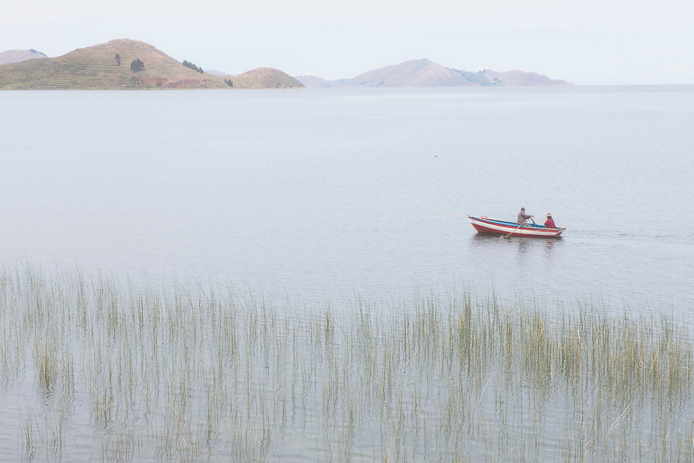 South America; Peru; Lake Titicaca; native paddle boat in morning fog