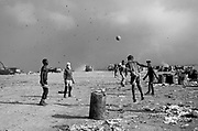 Dump workers play soccer, Rio de Janeiro, Brazil.