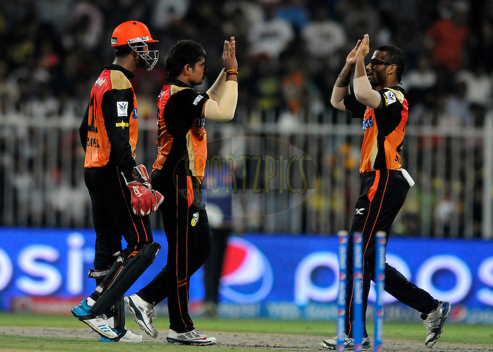 Karn Sharma of the Sunrisers Hyderabad celebrates the wicket of Brendon McCullum of The Chennai Superkings during match 16 of the Pepsi Indian Premier League 2014 between the Delhi Daredevils and the Mumbai Indians held at the Sharjah Cricket Stadium, Sharjah, United Arab Emirates on the 27th April 2014<br /> <br /> Photo by Pal Pillai / IPL / SPORTZPICS