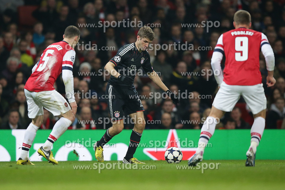 19.02.2013, Emirates Stadion, London, ENG, UEFA Champions League, FC Arsenal vs FC Bayern Muenchen, Achtelfinale Hinspiel, im Bild, Thomas MUELLER (FC Bayern Muenchen - 25) - Thomas VERMAELEN (FC Arsenal London - 5) - Lukas PODOLSKI (FC Arsenal London - 9) // during the UEFA Champions League last sixteen first leg match between Arsenal FC and FC Bayern Munich at the Emirates Stadium, London, Great Britain on 2013/02/19. EXPA Pictures © 2013, PhotoCredit: EXPA/ Eibner/ Gerry Schmit..***** ATTENTION - OUT OF GER *****