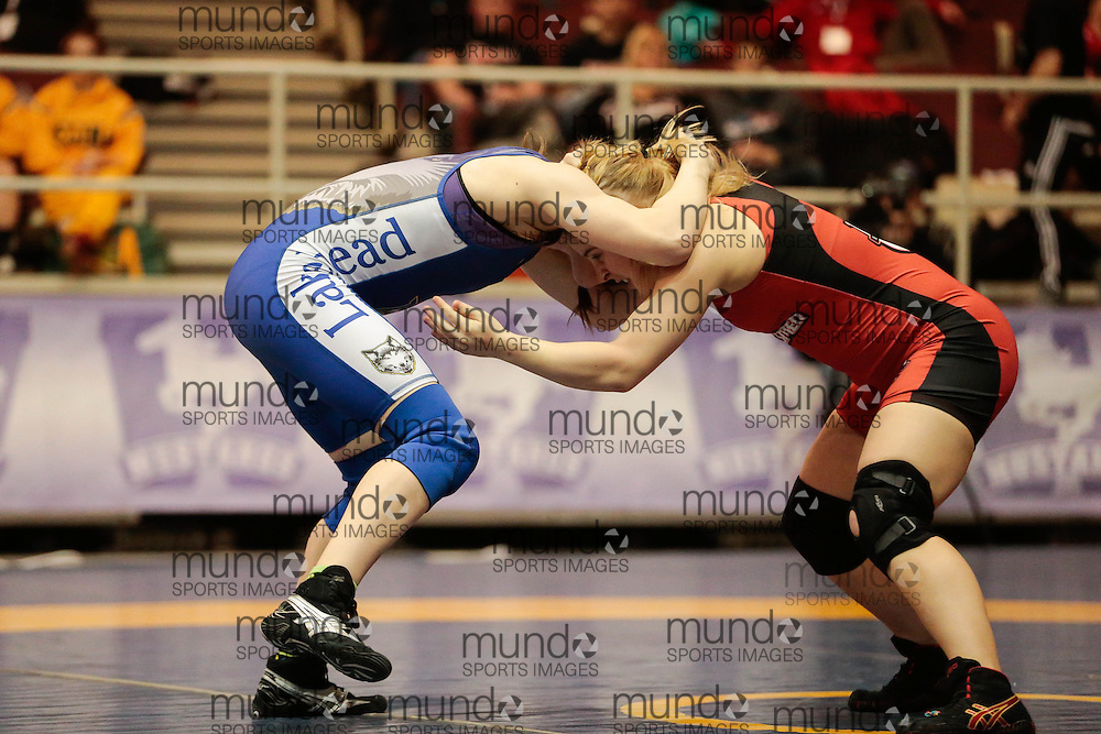 London, Ontario ---2013-03-02---  Emily Kessler of  The University Of Winnipeg takes on  Emma Horner of  Lakehead in the women's 55 KG 5th/6th match at the 2012 CIS Wrestling Championships in London, Ontario, March 02, 2013. .GEOFF ROBINS/Mundo Sport Images