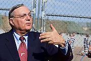 "04 FEBRUARY 2009 -- County Sheriff Joe Arpaio talks to reporters and tells them he does not to be compared to Hitler, as several prisoners did when they were marched into Tent City. Maricopa County Sheriff Joe Arpaio marched about 200 undocumented immigrants in the Durango Jail to ""Tent City"" where he will house the prisoners until or if they are deported. PHOTO BY JACK KURTZ"