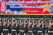 29 SEPTEMBER 2014 - NAKHON NAYOK, NAKHON NAYOK, THAILAND: Thai soldiers stand under a banner announcing the retirement of senior generals at Chulalomklao Royal Military Academy during the retirement ceremony for more than 200 Thai generals including Gen. Prayuth Chan-ocha, who led the 22 May coup against the civilian government earlier this year. Prayuth has been chief of the Thai army since 2010. After his retirement, Gen. Prayuth will retain his posts as head of the junta's National Council for Peace and Order (NCPO) and Prime Minister of Thailand. Under Thai law, military officers must retire at 60 years of age. The 200 generals who retired with Prayuth were also his classmates at the Chulalomklao Royal Military Academy in Nakhon Nayok.    PHOTO BY JACK KURTZ