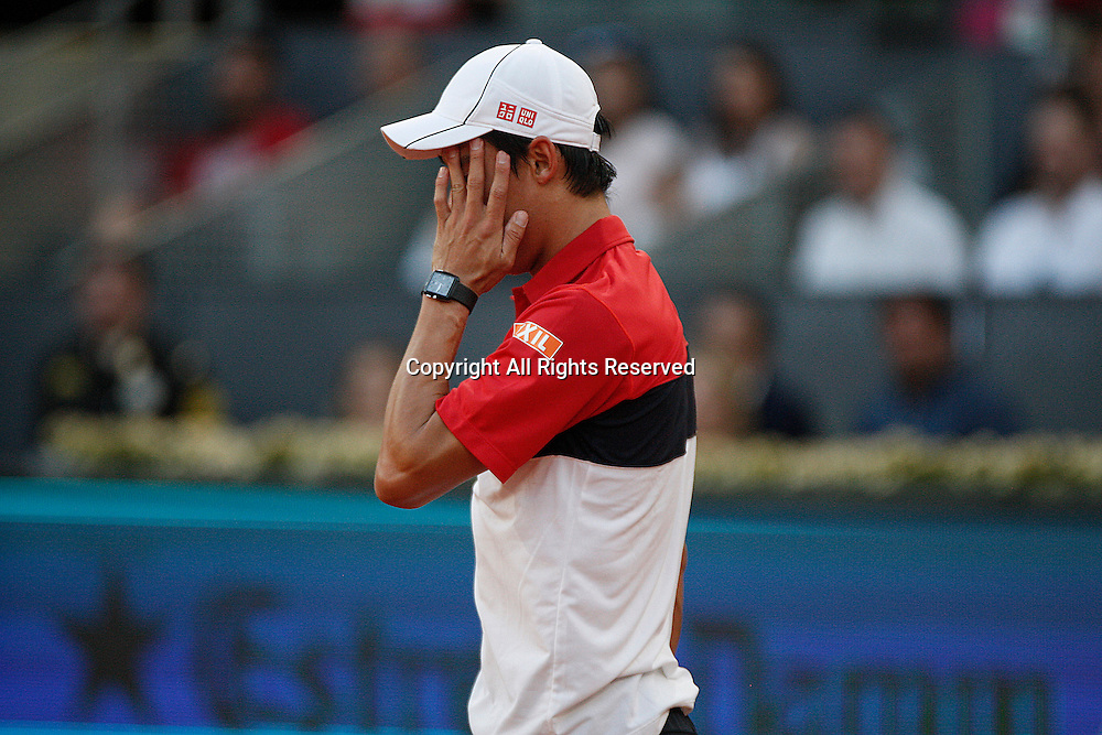 09.05.2015 Madrid, Spain. Kei Nishikori in action against Andy Murray in the semi-final of the Madrid Open tennis.