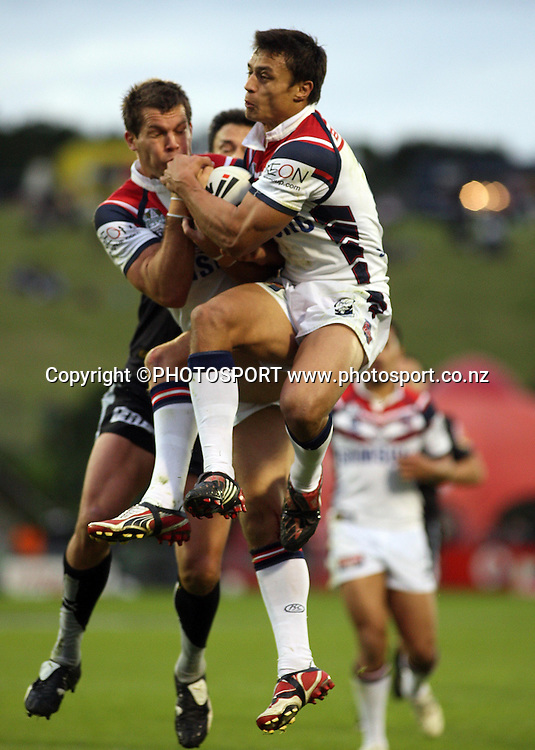 Rooster wing Sam Perrett jumps for the ball.<br />