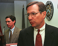 Robert Courtney, U.S. Attorney, Organized Crime Strike Force, left, and Michael R. Stiles, U. S. Attorney for Eastern District of  Pennsylvania, right, speak to reporters at a news conference announcing the charges brought against YBM,  Monday, June 7, 1999, in Philadelphia. YBM, a publicly traded Canadian Corporation, has been charged with conspiracy to commit mail fraud, and securities fraud in the U.S. (Photo by William Thomas Cain)