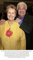 MR & MRS ANTONIO CARLUCCIO, he is the restaurant owner, at a party in London on 13th March 2001.OME 26