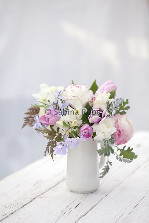 Spring flower arrangement with tulips, ranunculus, phlox and narcissi