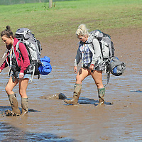 DARESBURY, UK:.Festival goers leave Creamfields festival closed early by extreme weather  on Sunday, 26th August 2012..PHOTOGRAPH BY TERRY KANE / BARCROFT MEDIA LTD..UK Office, London..T: +44 845 370 2233.E: pictures@barcroftmedia.com.W: www.barcroftmedia.com..Australasian & Pacific Rim Office, Melbourne..E: info@barcroftpacific.com.T: +613 9510 3188 or +613 9510 0688.W: www.barcroftpacific.com..Indian Office, Delhi..T: +91 997 1133 889.W: www.barcroftindia.com