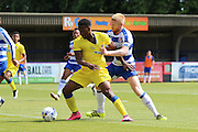 AC Wimbledon striker Dom Poleon beats Reading FC defender Paul McShane to the ball during the Pre-Season Friendly match between AFC Wimbledon and Reading at the Cherry Red Records Stadium, Kingston, England on 23 July 2016. Photo by Stuart Butcher.