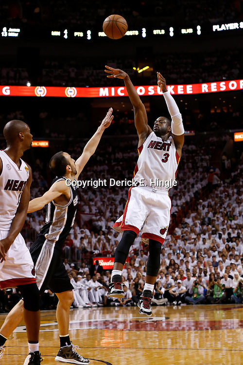 Jun 18, 2013; Miami, FL, USA; Miami Heat shooting guard Dwyane Wade (3) shoots against San Antonio Spurs shooting guard Manu Ginobili (20) during the first quarter of game six in the 2013 NBA Finals at American Airlines Arena.  Mandatory Credit: Derick E. Hingle-USA TODAY Sports